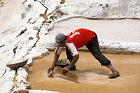 Man woking in the salt pans, Maras, Peru
