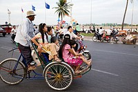 Family on Cyclo in Phnom Penh, Cambodia
