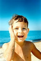 Close_up of a boy playing on the beach