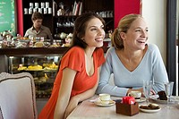 Female friends together at cafe