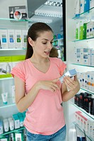 Young woman looking at beauty products in store