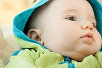 Infant wearing hooded sweatshirt, close-up (thumbnail)