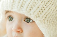 Baby wearing knit hat, close_up