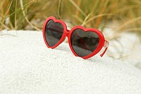 Heart_shaped sunglasses on beach