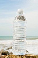 Bottle of water on shore