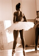 Two ballet dancers practicing in a studio