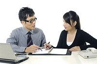 Businessman and a businesswoman discussing a document