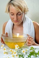 Woman using camomile for inhalation