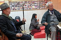 WOMAN PRAYING TO BUDDHA AND MUSICIANS PLAYING TRADITIONAL CHINESE MUSIC, ALTAR TO BUDDHA, PARIS 75, 13TH ARRONDISSEMENT