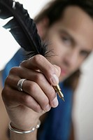Man holding a quill pen
