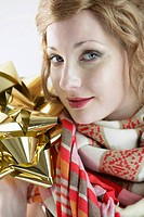 Portrait of a beautiful young woman holding shiny decorative