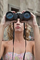 Woman with binoculars sightseeing