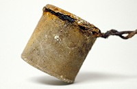 rusted tin can attached to wire