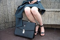 Woman´s legs and briefcase