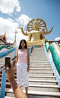 Thailand, Koh Samui. Thai woman posing for a picture                                                                                                  ...