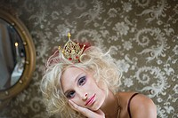 Portrait of contemplative blonde woman wearing crown