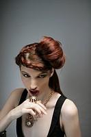 Portrait of sexy woman wearing gold jewelry, studio shot