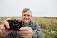 Man outdoors with camera