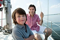 Father and son on board yacht, portrait