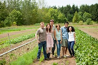 Group of people in vegetable field on farm