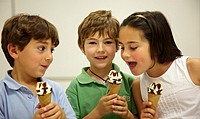 Children eating ice-cream cones, tasting session in sensory lab, AZTI-Tecnalia Marine and Food Research Center, Derio, Bizkaia, Euskadi, Spain
