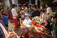 Muslim boys and girls aged 4 to 6 years sit on carved and painted wooden horses at beginning of circumcision rites Narmada Lombok Barat NT B Indonesia