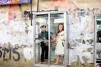 Child mannequins in a glass case, advesrtising clothing, street scene in El Alto, Bolivia