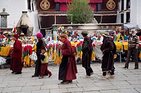 TIBETANS circumnambulate the Jokhang Temple along the BARKOR a TIBETAN Bazaar _ LHASA, TIBET
