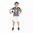 a boy in sportswear holding a soccer ball