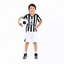 a boy in sportswear holding a soccer ball