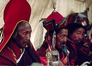 BUDDHIST and BONPO MONKS BLESS believers with sacred objects at a Tibetan Buddhist FESTIVAL in DO TARAP VALLEY _ DOLPO DISTRICT, NEPAL