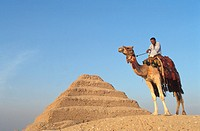 Egypt. Sakkara pyramid and camel rider
