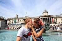 Romantic couple at Trafalgar Square, London