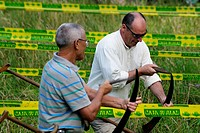 Asturian traditional sports, championship hay mowers sharpening their scythes Two Benia de Onis, Asturias, Spain