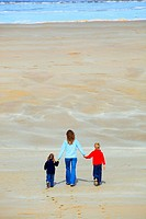 family on sandy beach, Sutherland, Scotland