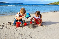 children playing on sandy beach, Sutherland, Scotland