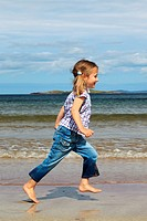 girl running on sandy beach, Sutherland, Scotland