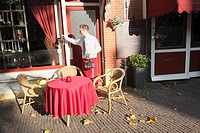 Waiter hanging up lamps on the terrace, Amersfoort, Utrecht province, Netherlands