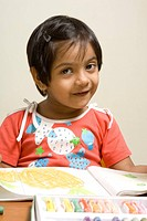 South Asian Indian four year old girl khushi karve looking her drawing book in her house , Bombay Mumbai , Maharashtra , India MR688
