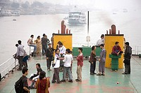 People traveling in Cruise boat in Burigunga Buri Gunga River , Sadarghat Boat terminal , Dhaka , Bangladesh