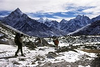 Trekkers descent from Everest Base Camp with a backdrop of Ama Dablam, Kangtega and Tamserku peaks, near Dugla, Khumbu valley, Nepal