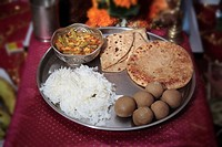 Thali , a plate of variety vegetarian food , Prasad , offerings to Lord Ganesh during Ganesh Ganapati Festival , Maharashtra , India