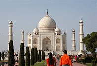 Tourists at Taj Mahal Seventh Wonders of World on the south bank of Yamuna river , Agra , Uttar Pradesh , India UNESCO World Heritage Site