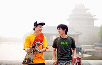 two young men playing skateboarding in Beijing