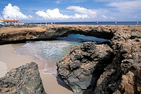 Antilles, Aruba, 100 feet long rock natural bridge on the North coast