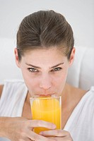 Woman drinking a glass of orange juice