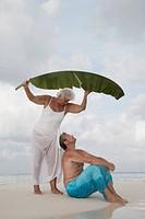 Maldives, Ari Atoll, senior couple on the beach