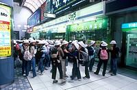Japan, Tokyo. Schoolchildren in Shinagawa railway station
