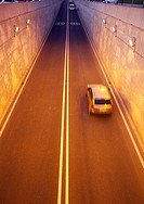 cars and motorcycles passing through a tunnel