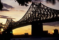bridge, Montreal, Quebec, Canada, a view of Jacques_Cartier Bridge Pont Jacques_Cartier crossing the Saint Lawrence Seaway at sunset in Montreal in th...